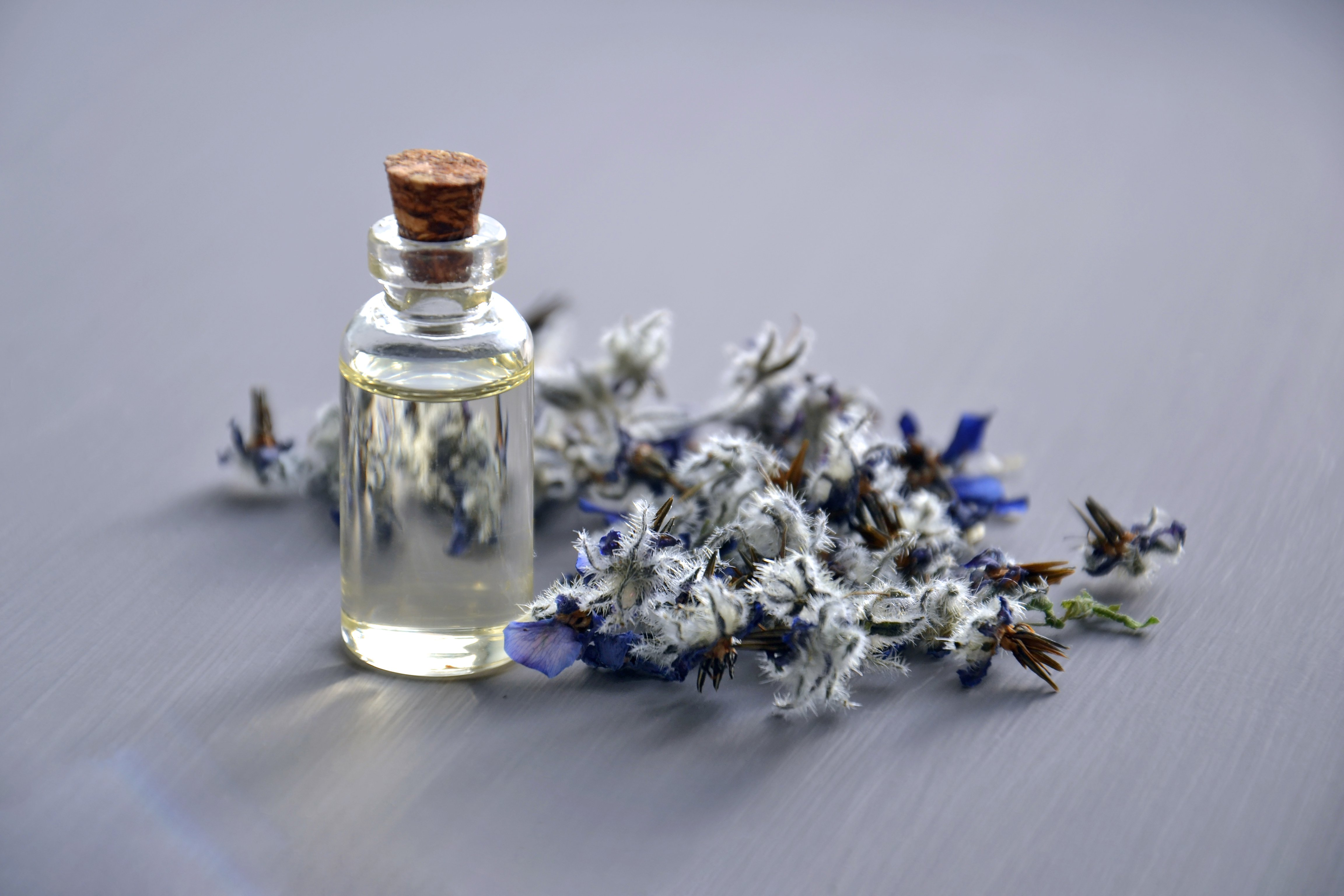 photo of bottle with cork lid and lavender sprigs